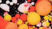 tingidos : Amazing multicolored bubbles of paint on the oil surface. Paint in oil. Stock Footage