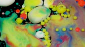 saturado : Amazing multicolored bubbles of paint on the oil surface. Paint in oil. Stock Footage