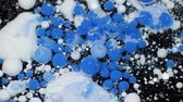 psychedelic colors : Amazing white and blue bubbles of paint on the oil surface. Paint in oil. Stock Footage