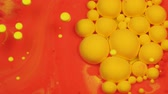 tingidos : Amazing red and yellow bubbles of paint on the oil surface. Paint in oil. Stock Footage