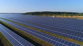 modul : Aerial drone footage. Low flight over solar panel farm. Renewable green alternative energy Stock mozgókép