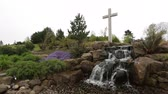 buddhismus : Tripod shot of a landscaped waterfall with a cross