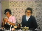 pamięć : 8mm vintage archival footage of girls at a dinner table laughing during christmas time