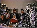 pamięć : 8mm vintage archival footage of guests at a dinner table during christmas time