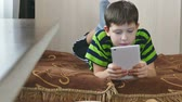 little : boy playing on tablet game Stock Footage