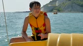 tekneler : boy teenager on a yacht. sailor bathe in the open ocean water on catamaran Stok Video