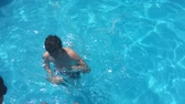 bathe in the pool water. children boy and girl swimming in the pool playing kids slow motion video