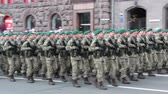 street parade : KIEV, UKRAINE - AUGUST 24, 2017: Military parade in Kyiv, to the Independence Day of Ukraine Rows of marching national police on Khreshchatyk street Stock Footage