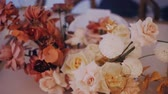 High angle shot of a beautiful wedding bouquet on the decirated dining table. Left to right. Middle shot. Стоковые видеозаписи