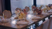 Middle parralax shot of beautifully decorated wedding party banquet table.