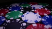 заподлицо : Poker Table With Poker Chips Turns In Casino. Many Poker Chips Spins on the Table in Darkness
