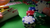 нервный : Gambling Poker Player Moves Chips on Table at Casino. Casino Chips, Aces And King. Winner In Poker. Poker Player Risk And Going All-in