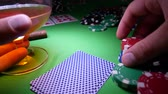 заподлицо : Gambling Poker Player Makes a Bet On The Green Table With Poker Chips. Cards On Table In Casino