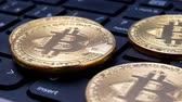 wallet : Gold Bitcoin BTC coins rotating on laptop keyboard. Digital coin btc money crypto currency on bitcoin farm in digital cyberspace. Worldwide virtual internet cryptocurrency and digital payment system Stock Footage
