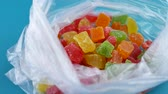 orange jelly : Candy Mix rotates plate with colorful cubes candied fruit. Turkish Delight Colorful Sweet Candy Delicious Concept as Background rotate