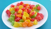 orange jelly : Candied fruit mix rotates on plate. Turkish Delight Colorful Sweet Candy Delicious Concept as Background rotate