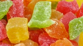 nozes : Rotates plate with colorful cubes candied fruit on white background. Macro Turkish Delight. Closeup concept as Background