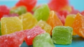 orange jelly : Colorful cubes candied fruit falling on green background. Turkish Delight Sweet Candy Delicious Concept as Background