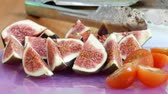 füge : Figs and tomatoes to make vegan salad. Cooking Vegetarian Salad with Vegetable at Restaurant or Home Stock mozgókép