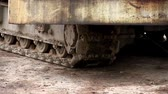 heavy : Continuous caterpillar tracks of the bulldozer. Detail of a rusty tractor protector iron tracks Stock Footage