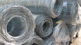 estendido : Stack of wire rod steel or aluminum mesh. Rolled wire production in factory Stock Footage