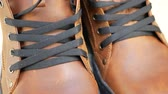 Pair of new brown leather working boots with black laces. Autumn or winter shoes concept