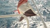 mávání : Flag of the country of Egypt from a yacht at sea with waves. Ship is swimming in Red Sea