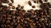 barista : Roasted brown coffee beans group falling down Stock Footage