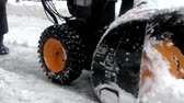 remoção : Snow-removal work with a snow blower in the winter