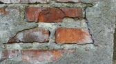 manchado : Old and torn surface of brick wall. Red brick wall for background texture
