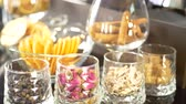 alkollü : Spices, cinnamon sticks and dried orange fruits slices for making alcoholic drink on bar counter in restaurant or night club Stok Video