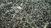 Scrap metal debris strip from metal lathe machine at factory