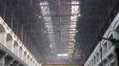 keretében : Old industrial warehouse with metal beams under ceiling in large heavy plant Stock mozgókép