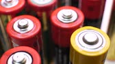 bidone : Different types of used batteries in heap Filmati Stock