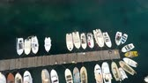 Small boats docked in harbor aerial motion view Vídeos