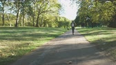 Young woman walking in the park in London UK