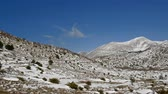 dalmatia : Nature park and mountain Biokovo in Croatia covered with snow on sunny winter day motion view