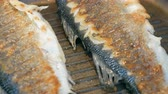 бас : Two fresh whole sea bass fish grilling on hot pan close up