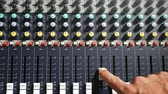 desvanecer : Adjusting fade sliders on audio mixer music console in studio top view Stock Footage