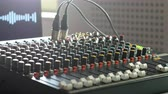 Audio mixing console with digital equaliyer and screen in music studio indoors