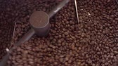 Mixing roasted coffee Стоковые видеозаписи