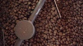 Mixing roasted coffee in slow motion close-up