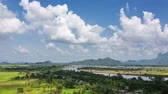 4K time-lapse of white clouds moving over beautiful rural landscape near Hpa-an,