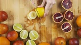 citrus fruit recipes : Cutting freshlemons on a wooden bench
