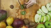 naturalistic : Slicing kiwifruit with a knife