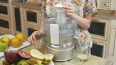 düşük kalorili : girl makes fresh homemade juice with electric blender