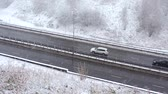 маршрут : Cars driving on snowy road in winter, traffic on highway in snowfall, blizzard