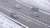 chauffeurs : Cars driving on snowy road in winter, traffic on highway in snowfall, blizzard