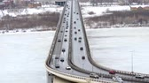 squall : Cars driving on snowy road in winter, traffic driving on the bridge, highway