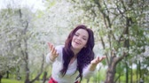 warmth : Young attractive woman with open arms in the park smiling